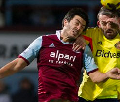 West Ham defender Tomkins charged after nightclub incident