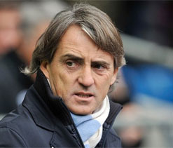 Manchester City to review manager Mancini`s position at end of season