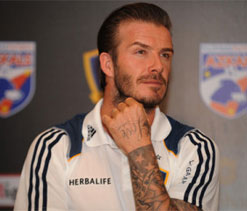 Beckham pays tributes to `father figure` Fergie