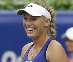 Caroline Wozniacki happy with Rory McIlroy and her form