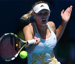 Shining Wozniacki puts Azarenka, Sharapova in shade at Australian Open 2014