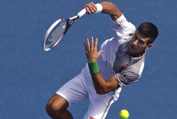 Australian Open 2014: Serena Williams shocked as Novak Djokovic stretches streak