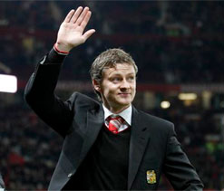 Prospective Cardiff boss Ole Gunnar Solskjaer watches match with owner