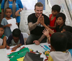 Beckham gives cheer in Philippines typhoon zone