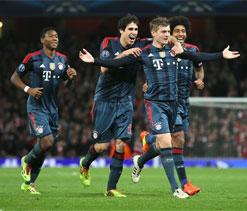 Kroos missile helps Bayern sink 10-man Arsenal