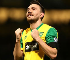 Norwich ease pressure on Hughton with win over Spurs