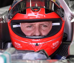 Michael Schumacher`s boss insists attempts to wake him up continue