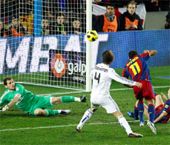 Real, Barca on course for Cup final showdown