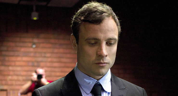 Oscar Pistorius argued with cop who touched his gun, friend says