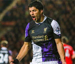 Milestone man Suarez sends Liverpool second