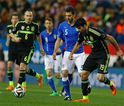 Pedro eclipses debutant Costa as Spain down Italy
