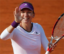 Halep eases into maiden grand slam semi-final in Paris